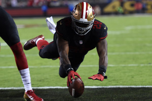 SANTA CLARA, CA - SEPTEMBER 14:  Carlos Hyde #28 of the San Francisco 49ers dives for a touchdown against the Minnesota Vikings in the second quarter of their NFL game at Levi's Stadium on September 14, 2015 in Santa Clara, California.  (Photo by Thearon W. Henderson/Getty Images)